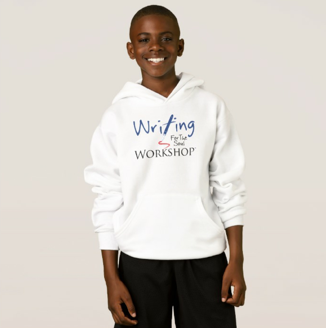 student smiling in WFTSW hoodie