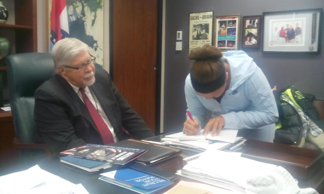 A'Brianna is pictured here signing an autograph of The Bully Diaries for the mayor of Springfield, MO.