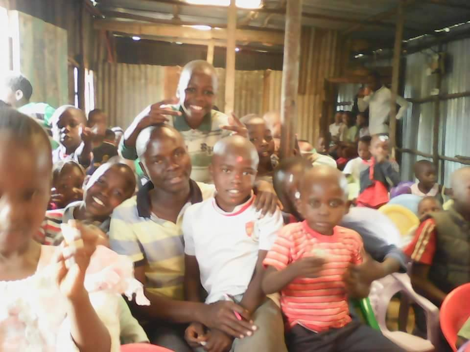 Vincint is pictured here playing with the children during free time at Touch Life Children Centre.